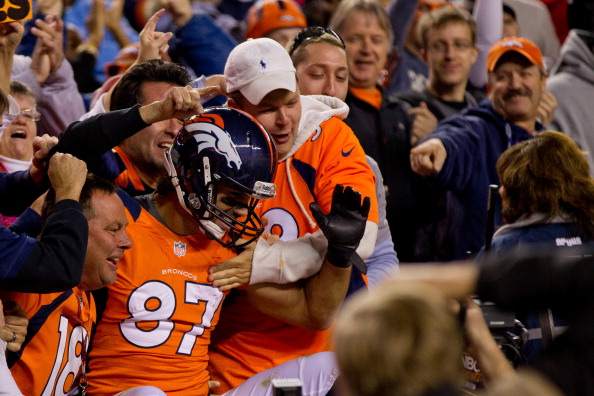 DENVER, CO - OCTOBER 28: Wide receiver Eric Decker #87 of the Denver Broncos celebrates in the stands with fans after scoring a touchdown during the second quarter against the New Orleans Saints at Sports Authority Field Field at Mile High on October 28, 2012 in Denver, Colorado. (Photo by Justin Edmonds/Getty Images)