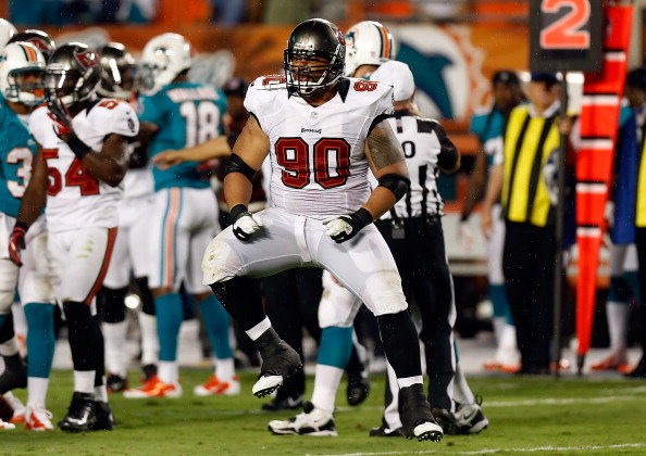 MIAMI GARDENS - AUGUST 10: Defensive tackle Roy Miller #90 of the Tampa Bay Buccaneers celebrates a play against the Miami Dolphins during the NFL Preseason Game at Sun Life Stadium on August 10, 2012 in Miami Gardens, Florida. (Photo by J. Meric/Getty Images)