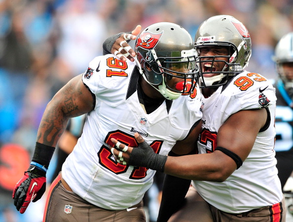 CHARLOTTE, NC - NOVEMBER 18:  Da'Quan Bowers #91 and Gerald McCoy #93 of the Tampa Bay Buccaneers celebrate after Bowers' sack of quarterback Cam Newton #1 of the Carolina Panthers during play at Bank of America Stadium on November 18, 2012 in Charlotte, North Carolina.  (Photo by Grant Halverson/Getty Images)