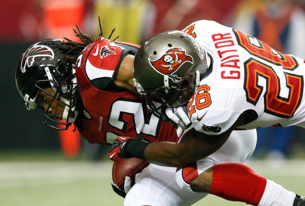 ATLANTA, GA - DECEMBER 30: Anthony Gaitor #26 of the Tampa Bay Buccaneers tackles Jacquizz Rodgers #32 of the Atlanta Falcons at Georgia Dome on December 30, 2012 in Atlanta, Georgia. (Photo by Kevin C. Cox/Getty Images)