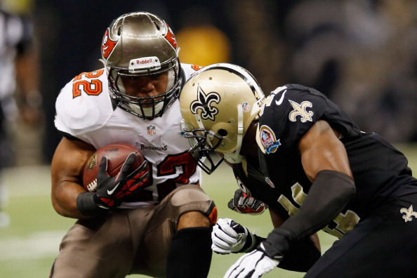NEW ORLEANS, LA - DECEMBER 16: Eric Wright #21 of the Tampa Bay Buccaneers is tackled by Roman Harper #41 of the New Orleans Saints at the Mercedes-Benz Superdome on December 16, 2012 in New Orleans, Louisiana. (Photo by Chris Graythen/Getty Images)