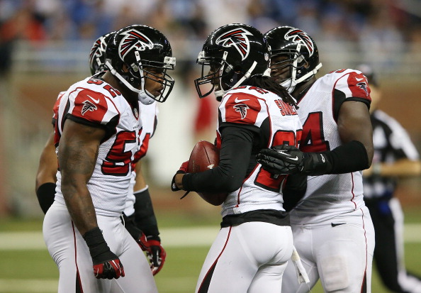 DETROIT, MI - DECEMBER 22: Asante Samuel #22 of the Atlanta Falcons celebrates with his teammates after intercepting Matthew Stafford #9 of the Detroit Lions during the fourth quarter at Ford Field on December 22, 2012 in Detroit, Michigan. The Falcons defeated the Lions 31-18. (Photo by Leon Halip/Getty Images)