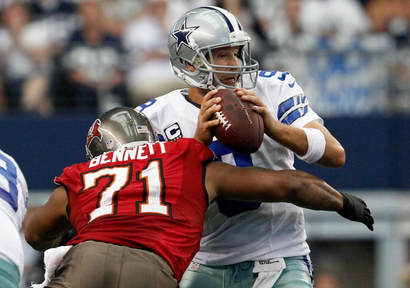 ARLINGTON, TX - SEPTEMBER 23: Tony Romo #9 of the Dallas Cowboys fumbles the ball after being hit by Michael Bennett #71 of the Tampa Bay Buccaneers at Cowboys Stadium on September 23, 2012 in Arlington, Texas. The Dallas Cowboys beat the Tampa Bay Buccaneers 16-10. (Photo by Tom Pennington/Getty Images)
