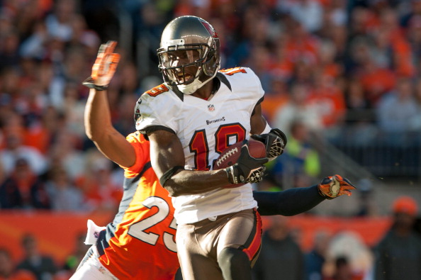 DENVER, CO - DECEMBER 2: Wide receiver Mike Williams #19 of the Tampa Bay Buccaneers runs for yards after a reception during a game against the Denver Broncos at Sports Authority Field Field at Mile High on December 2, 2012 in Denver, Colorado. (Photo by Dustin Bradford/Getty Images)