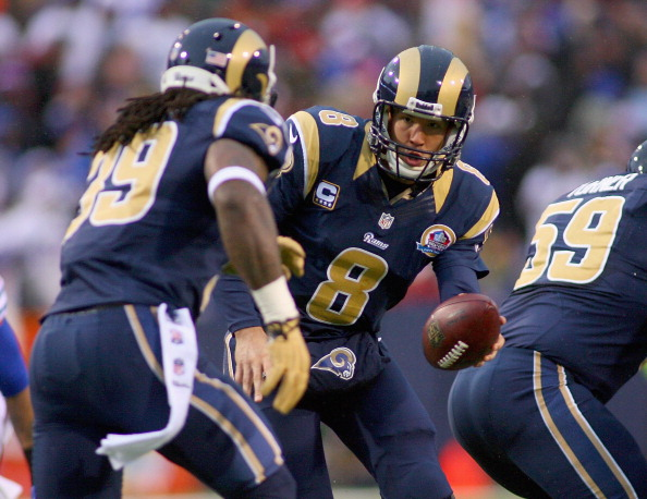 ORCHARD PARK, NY - DECEMBER 09: Sam Bradford #8 hands off to Steven Jackson #39 of the St. Louis Rams against the Buffalo Bills at Ralph Wilson Stadium on December 9, 2012 in Orchard Park, New York. (Photo by Rick Stewart/Getty Images)