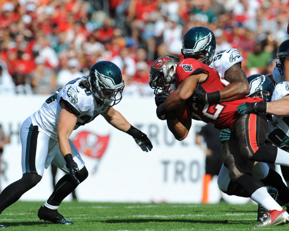 TAMPA, FL - DECEMBER 9: Linebacker Trent Cole #58 of the Philadelphia Eagles tackles running back Dough Martin #22 of the Tampa Bay Buccaneers December 9, 2012 at Raymond James Stadium in Tampa, Florida. The Eagles won 23 - 21. (Photo by Al Messerschmidt/Getty Images)