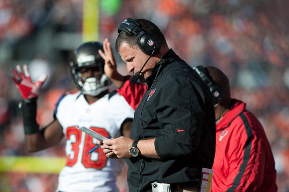 DENVER, CO - DECEMBER 2: Head coach Greg Schiano of the Tampa Bay Buccaneers looks over his playbook during a game against the Denver Broncos at Sports Authority Field Field at Mile High on December 2, 2012 in Denver, Colorado. (Photo by Dustin Bradford/Getty Images)