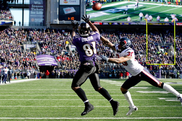 BALTIMORE, MD - JANUARY 15:  Anquan Boldin #81 of the Baltimore Ravens catches a pass against Jason Allen #30 of the Houston Texans to score a touchdown during the first quarter of the AFC Divisional playoff game at M&T Bank Stadium on January 15, 2012 in Baltimore, Maryland.  (Photo by Rob Carr/Getty Images)