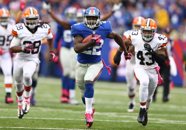 EAST RUTHERFORD, NJ - OCTOBER 07:  David Wilson #22 of the New York Giants scores a touchdown as  Usama Young #28 of the Cleveland Browns and  T.J. Ward #43 give chase during their game at MetLife Stadium on October 7, 2012 in East Rutherford, New Jersey.  (Photo by Al Bello/Getty Images)