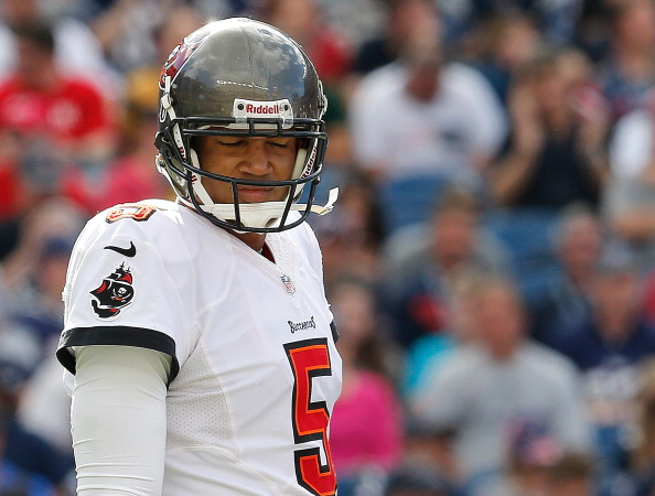 FOXBORO, MA - SEPTEMBER 22:  Josh Freeman #5 of the Tampa Bay Buccaneers reacts after an incomplete pass in the second half against the Tampa Bay Buccaneers at Gillette Stadium on September 22, 2013 in Foxboro, Massachusetts. (Photo by Jim Rogash/Getty Images)
