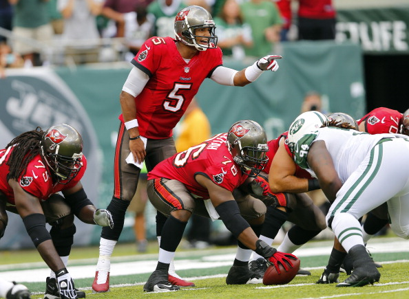 EAST RUTHERFORD, NJ - SEPTEMBER 8: Quarterback Josh Freeman #5 of the Tampa Bay Buccaneers calls a play from the line during a game against the New York Jets at MetLife Stadium on September 8, 2013 in East Rutherford, New Jersey. (Photo by Rich Schultz /Getty Images)