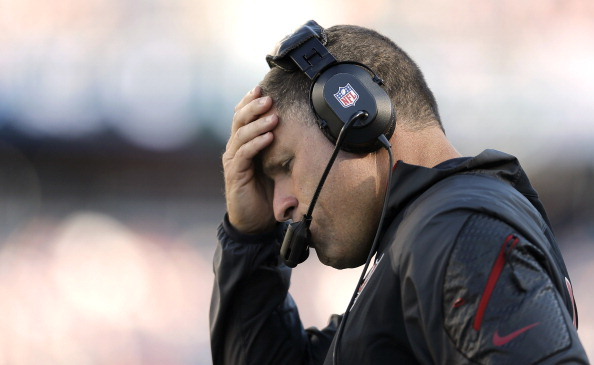 FOXBORO, MA - SEPTEMBER 22:  Head coach Greg Schiano holds his head during the fourth quarter of their 23-3 loss to the New England Patriots at Gillette Stadium on September 22, 2013 in Foxboro, Massachusetts.  (Photo by Winslow Townson/Getty Images)