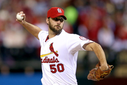 ST LOUIS, MO - OCTOBER 28:  Adam Wainwright #50 of the St. Louis Cardinals pitches in the first inning against the Boston Red Sox during Game Five of the 2013 World Series at Busch Stadium on October 28, 2013 in St Louis, Missouri.