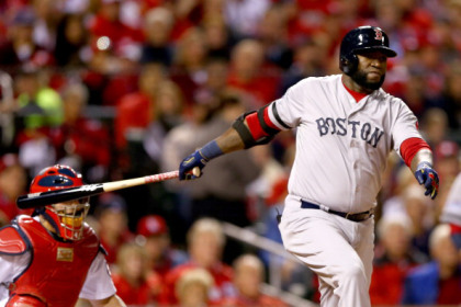 ST LOUIS, MO - OCTOBER 28:  David Ortiz #34 of the Boston Red Sox hits an RBI double scoring Dustin Pedroia #15 in the first inning against the St. Louis Cardinals during Game Five of the 2013 World Series at Busch Stadium on October 28, 2013 in St Louis, Missouri.