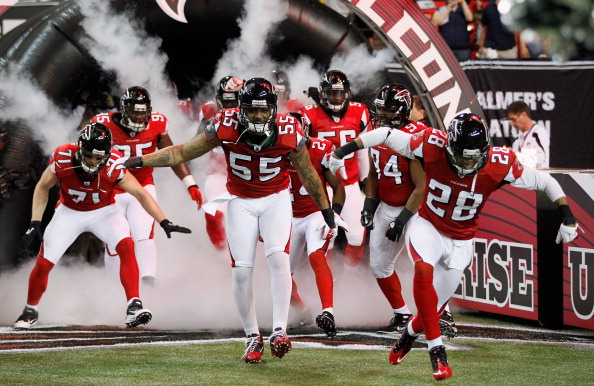ATLANTA, GA - DECEMBER 15:  John Abraham #55 and Thomas DeCoud #28 of the Atlanta Falcons lead their teammates onto the field against the Jacksonville Jaguars at the Georgia Dome on December 15, 2011 in Atlanta, Georgia.  (Photo by Kevin C. Cox/Getty Images)
