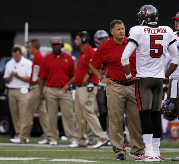 EAST RUTHERFORD, NJ - SEPTEMBER 16:  Head coach Greg Schiano talks with  Josh Freeman #5 of the Tampa Bay Buccaneers during a game against the New York Giants at MetLife Stadium on September 16, 2012 in East Rutherford, New Jersey.  (Photo by Jeff Zelevansky/Getty Images)