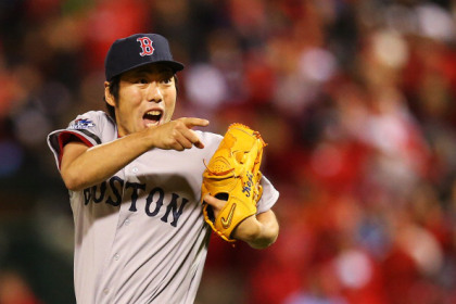 ST LOUIS, MO - OCTOBER 27:  Koji Uehara #19 of the Boston Red Sox celebrates after throwing out Kolten Wong #16 of the St. Louis Cardinals to win Game Four of the 2013 World Series at Busch Stadium on October 27, 2013 in St Louis, Missouri. The Red Sox defeated the Cardinals 4-2.