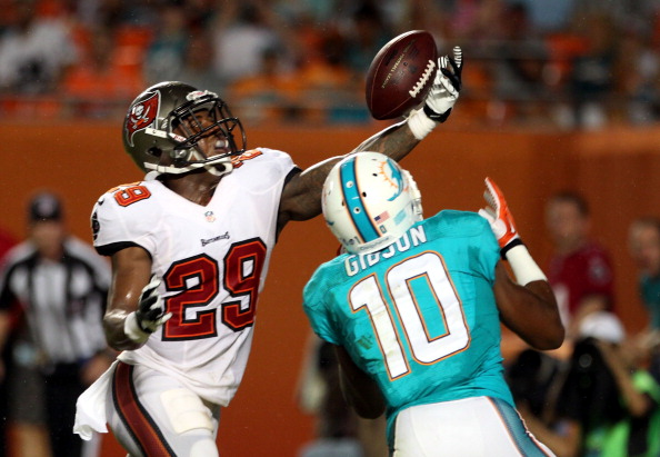 MIAMI GARDENS, FL - AUGUST 24:  Cornerback Leonard Johnson #29 of the Tampa Bay Buccaneers breaks up a pass in the end zone to receiver Brandon Gibson #10 of the Miami Dolphins at Sun Life Stadium on August 24, 2013 in Miami Gardens, Florida.  (Photo by Marc Serota/Getty Images)