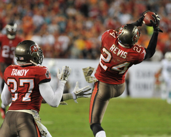 TAMPA, FL - NOVEMBER 11: Cornerback Darrelle Revis #24 of the Tampa Bay Buccaneers stretches for a 4th-quarter interception against the Miami Dolphins November 11, 2013 at Raymond James Stadium in Tampa, Florida. Tampa won 22 - 19. (Photo by Al Messerschmidt/Getty Images)