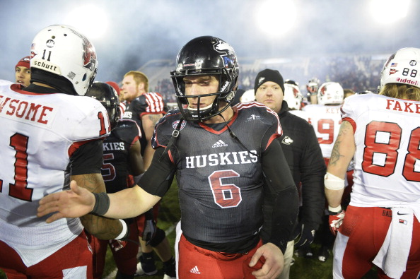 DEKALB, IL - NOVEMBER 13:  Jordan Lynch #6 of the Northern Illinois Huskies shakes hands with Ball State Cardinals players at Huskie Stadium on November 13, 2013 in DeKalb, Illinois. Northern Illinois defeated Ball State 48-27.  (Photo by Brian Kersey/Getty Images)