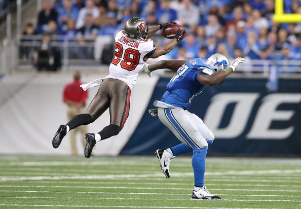 DETROIT, MI - NOVEMBER 24: Leonard Johnson #29 of the Tampa Bay Buccaneers intercepts a pass in front of Brandon Pettigrew #87 of the Detroit Lions and runs it back 48 yards for a touchdown during the second quarter of the game at Ford Field on November 24, 2013 in Detroit, Michigan.  (Photo by Leon Halip/Getty Images)