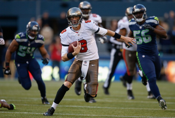 SEATTLE, WA - NOVEMBER 03:  Quarterback Mike Glennon #8 of the Tampa Bay Buccaneers rushes against the Seattle Seahawks at CenturyLink Field on November 3, 2013 in Seattle, Washington. The Seahawks defeated the Buccaneers 27-24 in overtime.  (Photo by Otto Greule Jr/Getty Images)