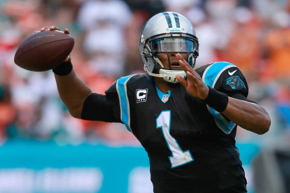 MIAMI GARDENS, FL - NOVEMBER 24:  Cam Newton #1 of the Carolina Panthers attempts to pass the ball in the second quarter against the Miami Dolphins at Sun Life Stadium on November 24, 2013 in Miami Gardens, Florida.  (Photo by Chris Trotman/Getty Images)