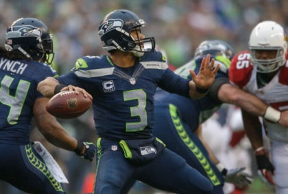 SEATTLE, WA - DECEMBER 22:  Quarterback Russell Wilson #3 of the Seattle Seahawks passes against the Arizona Cardinals at CenturyLink Field on December 22, 2013 in Seattle, Washington.   (credit: Otto Greule Jr/Getty Images)