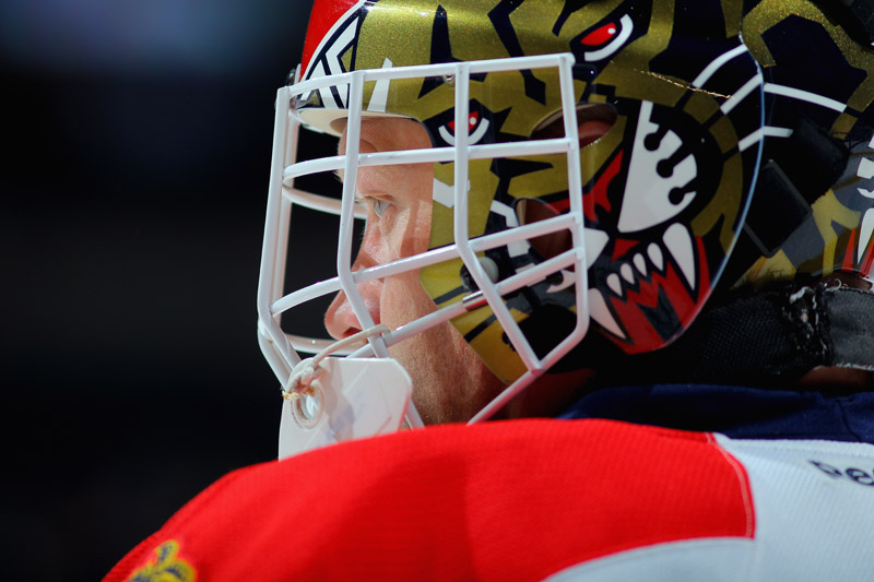 DENVER, CO - NOVEMBER 16:  Goalie Tim Thomas #34 of the Florida Panthers looks on during a break in the action against the Colorado Avalanche at Pepsi Center on November 16, 2013 in Denver, Colorado. The Panthers defeated the Avalanche 4-1.