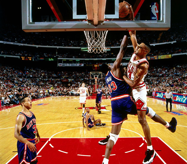 CHICAGO -  1994:  Scottie Pippen #33 of the Chicago Bulls goes for a dunk over Patrick Ewing #33 of the New York Knicks in Game six of the Eastern Conference Semifinals during the 1994 NBA Playoffs at Chicago Stadium in Chicago, Illinois.