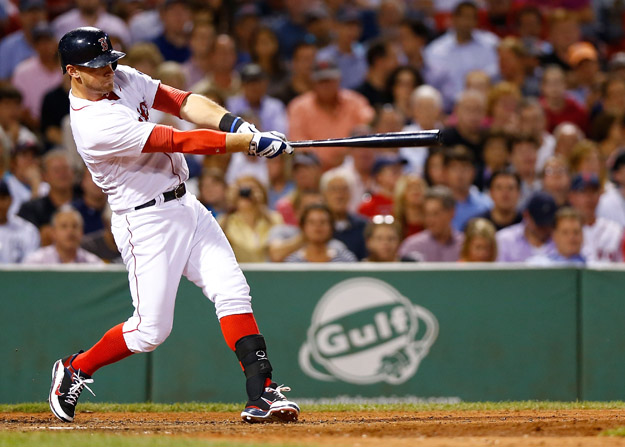 BOSTON, MA - SEPTEMBER 4: Will Middlebrooks #16 of the Boston Red Sox hits a grand slam home run in the 6th inning off of Al Alburquerque #62 of the Detroit Tigers during the game on September 4, 2013 at Fenway Park in Boston, Massachusetts.