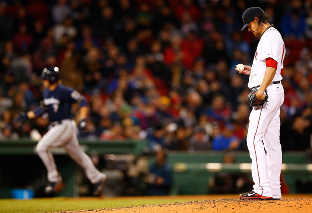 BOSTON, MA - APRIL 05:  Clay Buchholz #11 of the Boston Red Sox reacts after giving up a home run to Mark Reynolds #7 of the Milwaukee Brewers during the game at Fenway Park on April 5, 2014 in Boston, Massachusetts.