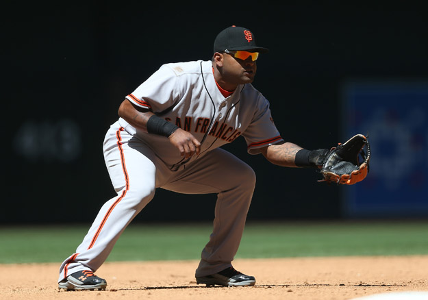 PHOENIX, AZ - APRIL 03:  Infielder Pablo Sandoval #48 of the San Francisco Giants in action during the MLB game against the Arizona Diamondbacks at Chase Field on April 3, 2014 in Phoenix, Arizona.   The Giants defeated the Diamondbacks 8-5.