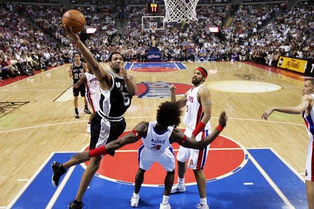 AUBURN HILLS, MI - JUNE 19:  Robert Horry #5 of the San Antonio Spurs tries to get to the basket through Ben Wallace #3 and Rasheed Wallace #36 of the Detroit Pistons in the first half of Game five of the 2005 NBA Finals at The Palace of Auburn Hills on June 19, 2005 in Auburn Hills, Michigan.