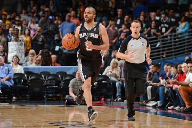 DENVER, CO - MARCH 28:  Tony Parker #9 of the San Antonio Spurs dribbles the ball against the Denver Nuggets on March 28, 2014 at the Pepsi Center in Denver, Colorado.