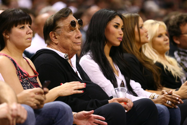 SAN ANTONIO, TX - MAY 19:  (2nd L) Team owner Donald Sterling of the Los Angeles Clippers and V. Stiviano watch the San Antonio Spurs play against the Memphis Grizzlies during Game One of the Western Conference Finals of the 2013 NBA Playoffs at AT&T Center on May 19, 2013 in San Antonio, Texas.