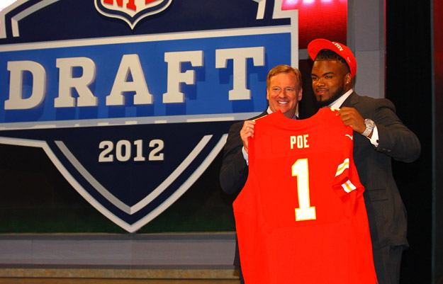NEW YORK, NY - APRIL 26:  Dontari Poe of Memphis holds up a jersey as he stands on stage with NFL Commissioner Roger Goodell after he was selected #11 overall by the Kansas City Chiefs in the first round of the 2012 NFL Draft at Radio City Music Hall on April 26, 2012 in New York City.