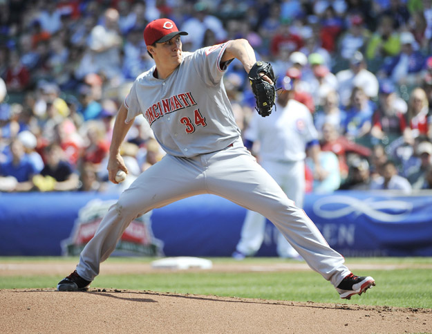 CHICAGO, IL - APRIL 20: Homer Bailey #34 of the Cincinnati Reds pitches against the Chicago Cubs during the first inning on April 20, 2014 at Wrigley Field in Chicago, Illinois.