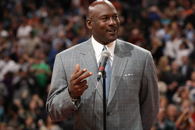 CHARLOTTE, NC - DECEMBER 21:  Michael Jordan, Owner of the Charlotte Bobcats unveils the new Charlotte Hornets logo during the game against the Utah Jazz at the Time Warner Cable Arena on December 21, 2013 in Charlotte, North Carolina.
