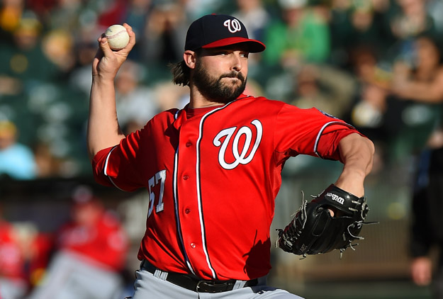OAKLAND, CA - MAY 10:  Tanner Roark #57 of the Washington Nationals pitches against the Oakland Athletics in the bottom of the first inning at O.co Coliseum on May 10, 2014 in Oakland, California.