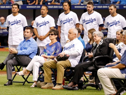 ST. PETERSBURG, FL - JUNE 7:  Members of the family of the late Don Zimmer, including his widow Soot (seated in black), are joined by members of the Tampa Bay Rays wearing Brooklyn Dodgers uniforms during a ceremony honoring him prior to a baseball game against the Seattle Mariners at Tropicana Field on June 7, 2014 in St. Petersburg, Florida. (Photo by Mike Carlson/Getty Images)