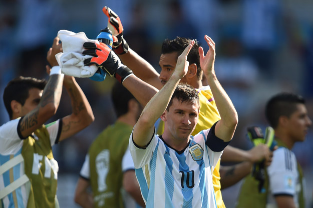 Argentina's forward and captain Lionel Messi claps to the fans as he celebrates with his teammates winning their Group F football match against Iran 1-0 with a last minute goal at the Mineirao Stadium in Belo Horizonte during the 2014 FIFA World Cup in Brazil on June 21, 2014. AFP PHOTO / PEDRO UGARTE        (Photo credit should read PEDRO UGARTE/AFP/Getty Images)