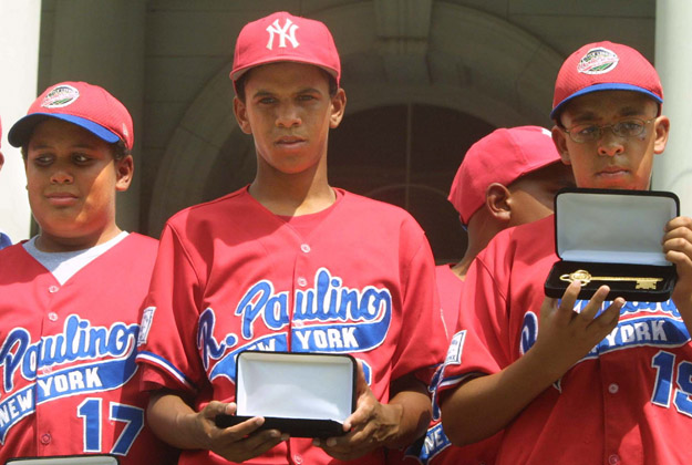 393788 05: (FILE PHOTO) Danny Almonte (C) and other members of the Rolando Paulino All-Stars Bronx Little League baseball team hold their keys to the city during a ceremony honoring the team August 28, 2001 in New York City. Dominican Republic officials said August 31, 2001 that Little League pitcher Danny Almonte is 14 years old, not 12 years old. The finding could strip his team of its third-place finish in the World Series.