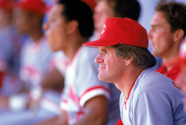 1985:  Pete Rose of the Cincinnati Reds watches from the dug-out during a MLB game in the 1985 season.