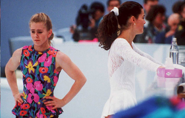 FILES, NORWAY - DECEMBER 15:  US figure skaters Tonya Harding (L) and Nancy Kerrigan avoid each other during a training session 17 February in Hamar, Norway, during the Winter Olympics. Kerrigan was hit on the knee in January 1994 during the US Olympic Trials and it was later learned that Harding's ex-husband and bodyguard masterminded the attack in hopes of improving Harding's chances at the US Trials and the Olympics.