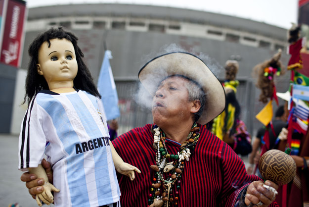 A Peruvian shaman performs a ritual of predictions for the FIFA World Cup Brazil 2014 in front of the National Stadium of Peru, in Lima June 10, 2014.