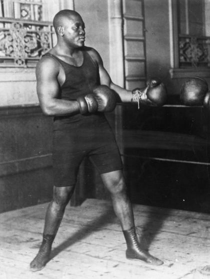 American heavyweight boxer Jack Johnson in action sparring.  (Photo by Topical Press Agency/Getty Images)