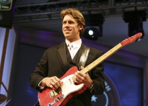 LAKE BUENA VISTA, FL - DECEMBER, 8th 2006: Driver Carl Edwards plays guitar with the Robert Randolph and The Family Band during the NASCAR Busch Series banquet at the Grand Floridian at Walt Disney World on December 8, 2006 in Lake Buena Vista, Florida. (Photo by Doug Benc/Getty Images for NASCAR)