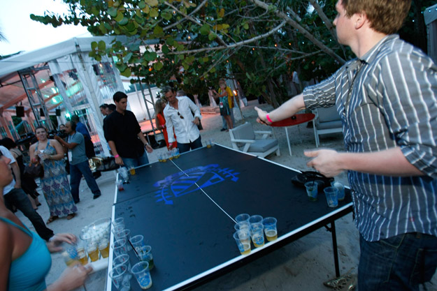 MIAMI - JULY 17: Guests play beer pong at the official kickoff party for Mercedes-Benz Fashion Week Swim at the Raleigh Hotel on July 17, 2008 in Miami, Florida.