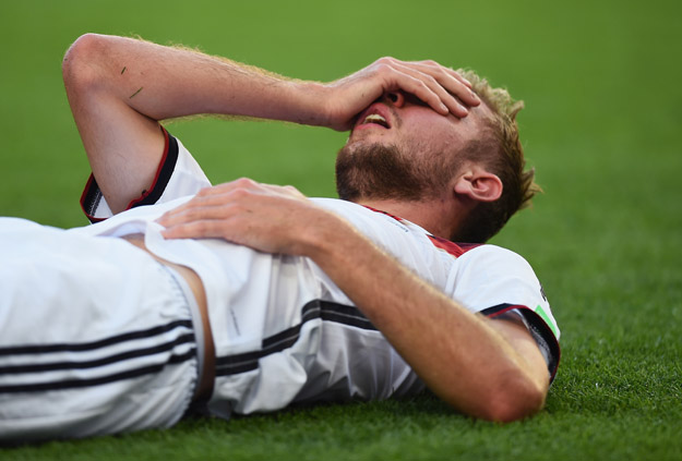RIO DE JANEIRO, BRAZIL - JULY 13:  Christoph Kramer of Germany lies on the pitch after a collision during the 2014 FIFA World Cup Brazil Final match between Germany and Argentina at Maracana on July 13, 2014 in Rio de Janeiro, Brazil.